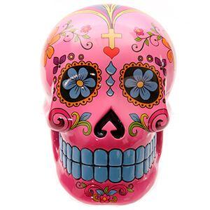 Teschio messicano rosa con fiori e denti azzurri
