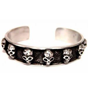 Braccialetto con teschi in metallo rigido argento e nero