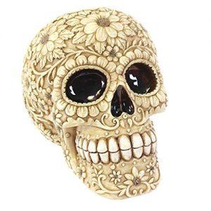 Salvadanaio a forma di scheletro messicano floreale bianco