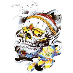 Tattoo con Teschio tibetano e fiore giallo