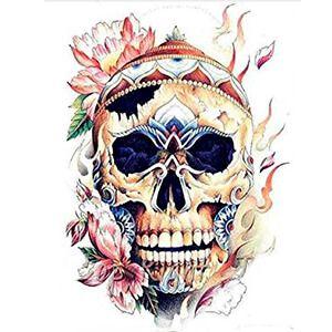 tatuaggio teschio tibetano con fiori